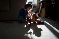 girl brushing stuffed dog - Documentary Family Photography