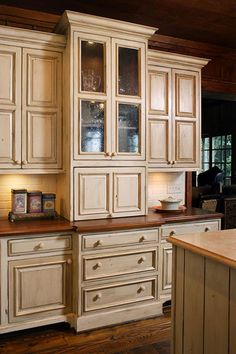 love this glass front cabinet!