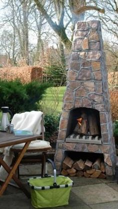 An small outdoor fireplace would be a nice addition to the back yard. I love the little spot for the firewood.