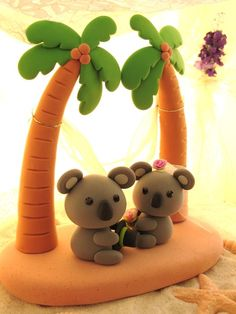 LOVE ANGELS Wedding Cake Topper-love Koala with Palm tree and hammock. via Etsy.