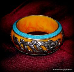 SALE ITEM Handcrafted Vintage Nepalese Amber Resin/Turquoise/White Metal Dragon/Lotus Blossom Bangle  by TemplesTreasureTrove #Treasured @  https://www.etsy.com/treasury/MjAxNzYwOTV8MjcyNzg3MTA0NA/helping-others-isnt-a-chore-it-is-one-of