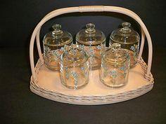 Hand painted nursery set, wicker basket. Jars held cotton, q-tips, soap, bath items. 1930's