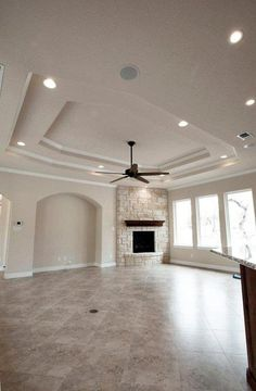 2 step ceiling treatment with stone fireplace accents.