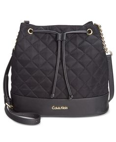 """Balance a trend-setting bucket silhouette with classic details-Calvin Klein's drawstring bag features chic quilting and chain accents.   Nylon; trim: faux leather   Imported   9-3/4""""W x 10-3/4""""H x 6""""D"""