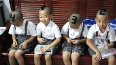 Mum shaves numbers into quads' heads // The mother of identical quadruplet boys shaved numbers into her sons' hair to help teachers and classmates tell them apart. Photo: Quirky China News