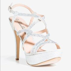 bb7ffd9edd1 Strappy Sparkly Silver Heels Size  US 8 Heels perfect for prom! Worn once!  Shoe runs half a size small.