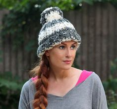 Make this sparking striped pom pom hat by Gina Michele with Lion Brand Gold Leaf! Pattern calls for 2 balls of yarn (grey silver & white gold) and size 13 knitting needles.
