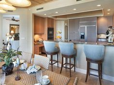 Counter seating with blue stools |  Trieste in Bay Colony, Naples, Florida