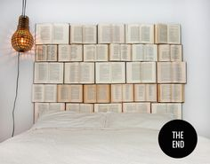 Book headboard  Always keep discarded books with you!  You can see how to create your own book headboard on the next page.    My advice: apart from your glasses, also keep pliers on your nightstand, just in case you fancy reading one of the books, nailed to your headboard.