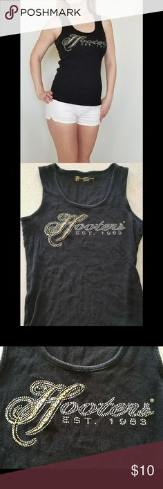 HOOTERS Rhinestone Tank Top HOOTERS Rhinestone Tank Top  ◾Condition: Used ◾Size: Large ◾Brand: HOOTERS ◾Cheetah print and rhinestone logo on front chest. ◾Missing just a few rhinestones pictures are above.  ◾100% Cotton   🐆 HOOTERS Tops Tank Tops