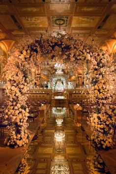 Inside Weddings Spring 2017 issue gorgeous wedding ceremony with lots of flowers at The Plaza hotel New York City