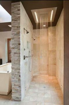 I love this rain shower! it really catches the eye and goes well with the brick wall divider. The tones of it create a soothing feeling.
