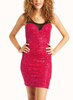 Sparkle like a disco ball in this stretchy dress with sequins