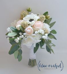 This wedding bouquet is one of our deluxe designs. Only the highest quality silk flowers have been included. Blush and cream colored peonies, ranunculus, hydrangea, and anemones are separated by sprigs of wildflowers and seeded eucalyptus. The shape of this bouquet adds to its unique style and design and creates a sense of luxury and elegance. The stems have been wrapped in our cream lace. Perfect bridal bouquet! You will not be disappointed with this stunning piece. This wedding bouquet is…