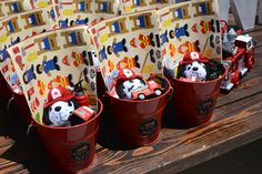 Firetruck and dalmatian themed favor pails.