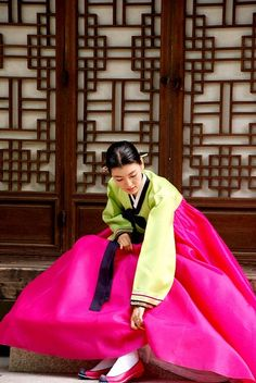 Colorful hanbok, traditional Korean dress. Notice hair is worn tightly pinned back. Loose hair signifies mourning.