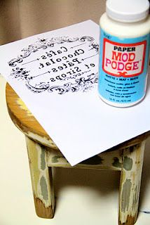 Reverse image and print with an  inkjet printer. Cut out and paint both the stool and the printed side of the image with Mod Podge Stick it to the stool, smoothing out, then dry over night. / Rub the top with wet fingers or wet sponge until the white paper becomes soggy enough to rub off.  Don't to rub too much or the ink will rub off. I then put a final glaze of Mod Podge (I used the matt finish) over the entire stool to seal it.