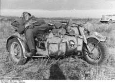 Soldier of German 24th Panzer Division sleeping on the sidecar of a R75 motorcycle, southern Russia, Aug-Sep 1942
