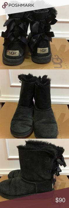"""Ugg """"Bailey Bow"""" short boots!! Black, fairly used but definitely still has years to wear them. Extremely plush and comfy inside with the sheepskin fur. Willing to negotiate price. Size 4 kids fits women's size 5/6 !!!  Shoes will/have been cleaned and checked for quality assurance. UGG Shoes Boots"""