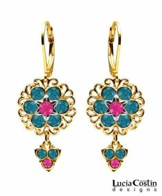 Dangle Flower Earrings by Lucia Costin Set with Dark Turquoise and Fuchsia Swarovski Crystals, Ornate with Filigree Details, 6 Petal Middle Flower and Fancy Charms; 14K Yellow Gold over .925 Sterling Silver Lucia Costin. $57.00. Lucia Costin flower drop earrings. Unique jewelry handmade in USA. Floral design accompanied by cute details. Update your everyday style with inspiration when wearing this piece of jewelry. Amazingly designed with blue zircon and fuchsia Swarovski crystals