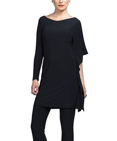 Edgy and asymmetrical, this tunic enhances an ensemble with its effortlessly chic silhouette. A single angel sleeve adds an extra-trendy touch.Measurements (size S): 36'' long from high point of shoulder to hem70% polyester / 20% rayon / 10% spandexMachine wash; hang dryMade in the U...