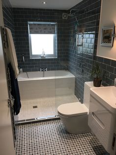 Look at the great use of space with a bath and a shower in this innovative design. David from Gateshead has created a semi wet room layout allows him to have the best of both worlds. why not try it yourself? With our stylish Planet White wall hung vanity unit and modern metro tiles this bathroom really is practical and on trend.