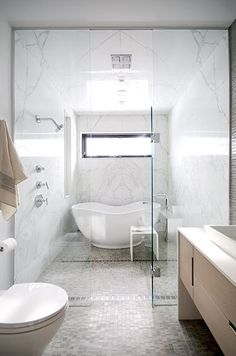 This idea has really intrigued me, stacking a shower in front of a bathtub.