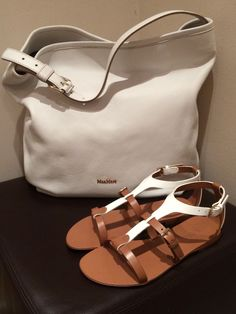 "MaxMara ""Amadeus"" white leather shoulder bag and Max Mara tan and white leather sandals.  Prices on request"