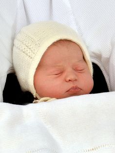 Pin for Later: You'll Love Seeing Princess Charlotte's Debut Side by Side With George's The Baby From Above: Princess Charlotte Though her hair was covered in a hat, Charlotte's sweet cheeks were on full display.