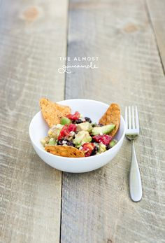 The Almost Guacamole #Recipe by The Fresh Exchange. Lime, tomato, avocado, corn, and black beans. Sounds deLISH!