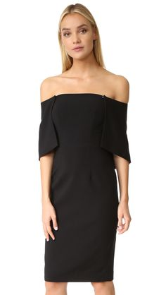 Buy it now. Black Halo Eloise Sheath Dress - Black. A Black Halo dress in a classic sheath profile. The overlay is crafted with two hidden snaps, which allow it to be worn long and flowing, or draped as a capelet. Boning structures the strapless bodice. Hidden side zip. Lined. Fabric: Suiting. Shell: 62% polyamide/33% viscose/5% elastane. Lining: 95% polyamide/5% elastane. Dry clean. Made in the USA. Imported materials. Measurements Length: 35.5in / 90cm, from center back Measurements from…