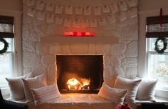 Another shot of the gorgeous painted stone fireplace!  From:  Most Lovely Things Advent Calendar