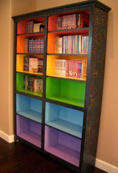 Rainbow bookcase - yes, please. (Via Paint Up's FB.)
