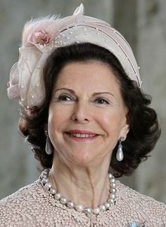 HM Queen Silvia wearing the pearl earrings and necklace from the Bernadotte Family Foundation for the christening of her granddaughter Princess Estelle - May 22, 2012.