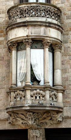 balcony with roman columns.