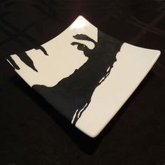 Hand Painted Self Portrait on a swoop sushi ceramic plate.  Painted by me at Color Me Mine.