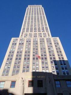 Empire State Building, New York. It has a roof height of 1,250 feet (381 meters), and with its antenna spire included, it stands a total of 1,454 ft (443.2 m) high.