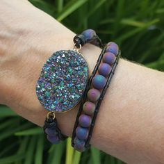 This double wrap bracelet features 6mm rainbow beads on dark brown leather which surround a glittering rainbow, gold edged druzy. The druzy stone in this bracelet is a beautiful rainbow color which sp