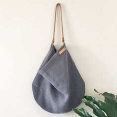 A beautiful blue European linen bag / linen hobo slouch shoulder bag with leather strap / oatmeal / beige / stone / linen slouch bag / fabric hobo bag Interior : grey cotton lining Exterior : dusty blue superior linen blend Measurements: ———- Slouch Bags, Linen Bag, Stitching Leather, Dusty Blue, Hobo Bag, Beige, Shoulder Bag, Leather Bags, Fabric