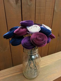 Handmade paper flower bouquet using purple, violet and navy blue flowers.    https://www.etsy.com/shop/ThePaperFlowerbed