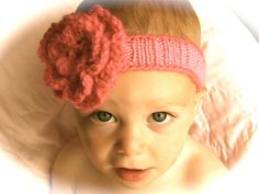 This is a simple headband, topped with the with the flower of your choice. I recommend the Pacifier Clips: Flower, by Susan B. Anderson (knit) or Slinky Crochet Flower by Teresa Richardson (crochet)