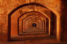 Illuminated Arches. Fort Jefferson, Dry Tortugas, Florida by Paul Marcellini.