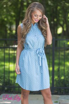 You're going to love wearing this sweet chambray dress all summer long! Featuring a twist on a classic shirt dress, we adore the white polka dot print, matching fabric belt, and cute collar on the front!
