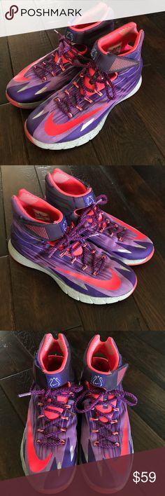 Nike Zoom basketball shoes size 9 Nike Zoom basketball shoes in a men's size 9. Limited edition purple and pink style. Only worn a few times. In excellent gently used condition. Nike Shoes Athletic Shoes