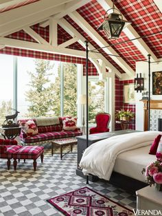 This Utah mountain house's master bedroom is characterized by a Madeline Stuart bed from Jerry Pair and a pendant by Paul Ferrante. The carpet is by Anthony Monaco Carpet & Textile Design.