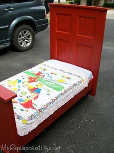 Toddler bed made from one old door. Soooo sweet.