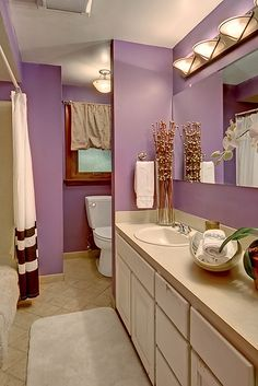 Dark Brown Cabinets In A Purple Bathroom New Home Design