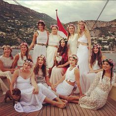 Royal Bachelorette party for Tatiana Santo Domingo - all white, flower crowns, puppies and a yacht. Amazing.