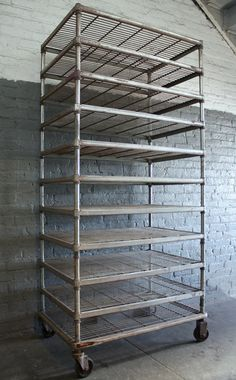 wouldn't this make a great drying rack for small to med paintings?  vintage bakers rack // metal shelving unit by Reclaimbk on Etsy, $250.00
