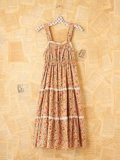 I love this vintage 1970's tiered prairie dress from Free People. I also love the background....great idea for displaying jewelry or clothes!